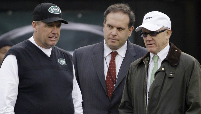 Jets owner Woody Johnson, right, made GM Mike Tannenbaum, center, pay for the team's recent misadventures but held onto head coach Rex Ryan.