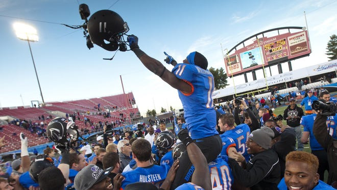 Boise State wide receiver Shane Williams-Rhodes is hoisted onto the shoulders of teammates after the MAACO Bowl victory against Washington in Las Vegas on Dec. 22. On Monday, the Broncos had even more reason to celebrate, with a lucrative return to the Mountain West Conference.