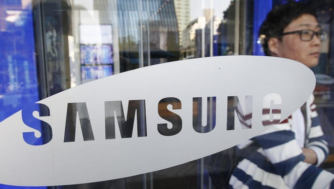 A visitor passes by the entrance way to Samsung Electronics Co.'s showroom at its headquarters in Seoul, South Korea, in Oct.