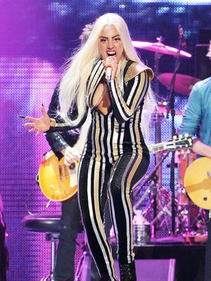 Singer Lady Gaga performs with The Rolling Stones at the Prudential Center in Newark, NJ on Dec. 15.