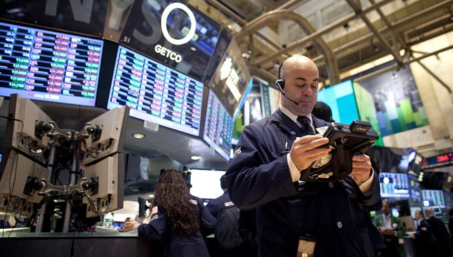 Traders work on the floor of the New York Stock Exchange on Monday in New York City.