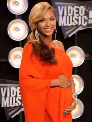 Beyonce shows off her baby bump on the red carpet at the MTV VMAs on Aug. 28, 2011.