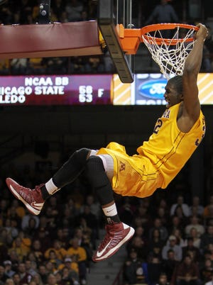Minnesota's Trevor Mbakwe throws down a dunk during the second half of the 76-63 win over Michigan State.