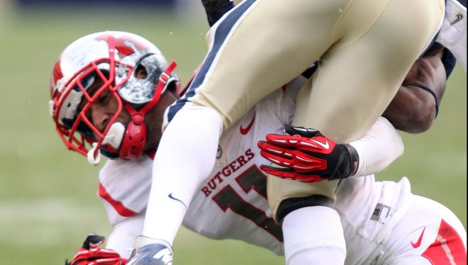 Rutgers cornerback Logan Ryan (11) tackles Pittsburgh's Ray Graham earlier this season. Ryan announced his intention Monday to enter the NFL draft as a junior.