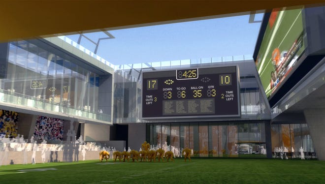 This undated artist's rendering shows plans for a new College Football Hall of Fame facility in Atlanta. The hall is moving from South Bend, Ind., where it's been plagued by low attendance. The new facility will have its groundbreaking in January and is scheduled to open in time for the 2014 college football season.