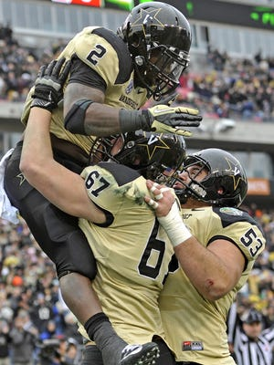 Vanderbilt running back Zac Stacy celebrates with Wesley Johnson after a second-quarter touchdown.