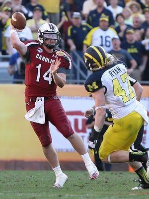 South Carolina quarterback Connor Shaw (14) throws a pass over Michigan linebacker Jake Ryan (47) during the second half of Tuesday's Outback Bowl.