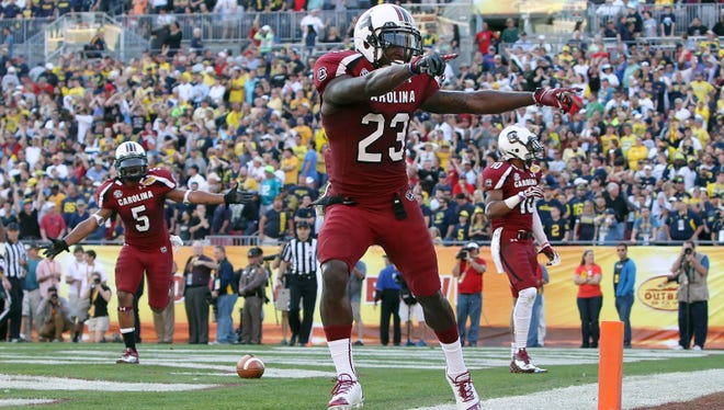 South Carolina wide receiver Bruce Ellington reacts after he scores the game-winning touchdown with 11 seconds left against Michigan in the Outback Bowl.