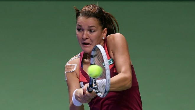 Agnieszka Radwanska, seen here in October, advanced to the quarterfinals with a straight-sets victory.