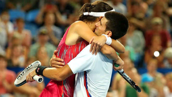 Ana Ivanovic and Novak Djokovic of Serbia embrace after winning the mixed doubles match and the tie against Ashleigh Barty and Bernard Tomic of Australia at  the Hopman Cup.