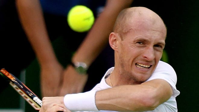 Nikolay Davydenko of Russia fires a backhand during his victory Wednesday against countryman Mikhail Youzhny at the Qatar Open.