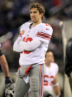 New York Giants quarterback Eli Manning (10) on the sideline during the game against the Baltimore Ravens at M&T Stadium.