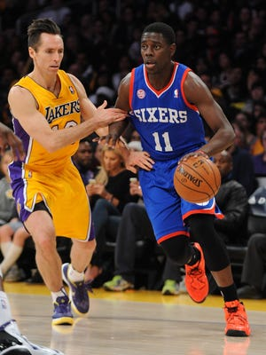 Los Angeles Lakers point guard Steve Nash (10) guards Philadelphia 76ers point guard Jrue Holiday (11) in the first half of the game at the Staples Center.