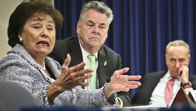 Rep. Peter King, center, and Sen. Chuck Schumer, right, listen as Rep. Nita Lowey speaks during a news conference about Superstorm Sandy aid.