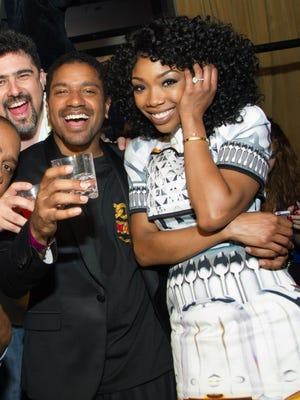 Brandy and her fiancé, Ryan Press, are seen on New Years Eve at Lavo Nightclub in Las Vegas.