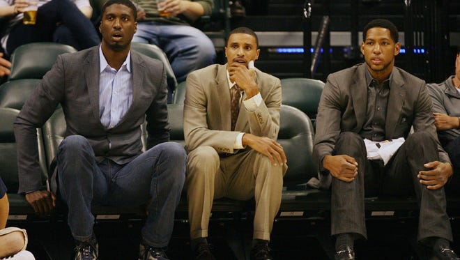 From left Indiana Pacers Roy Hibbert , George Hill , and Danny Granger watch from the bench in street clothes during a game against the Minnesota Timberwolves earlier this season.