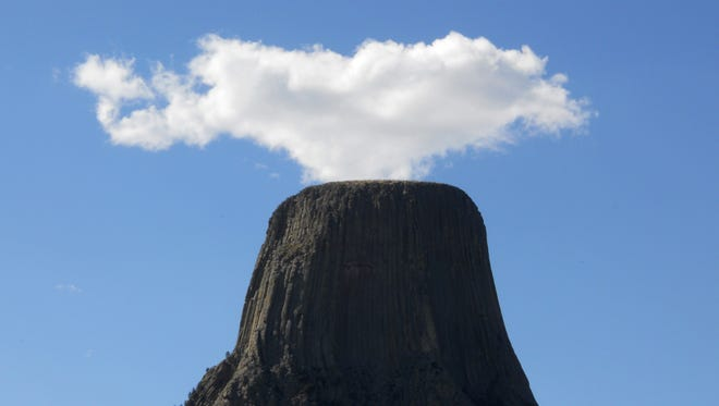 Devil's volcano? A lone cumulus cloud appears to emanate from the top of Devil's Tower in Wyoming in 2010.