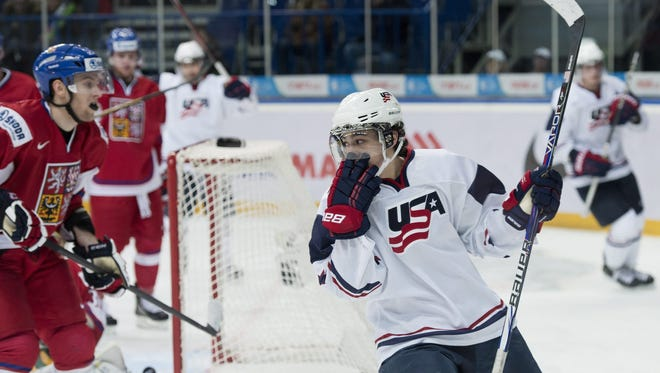 Team USA forward Johnny Gaudreau celebrates a second-period goal. He scored three to continue his recent outburst.