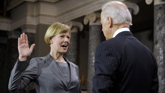 Vice President Biden administers the oath to Sen. Tammy Baldwin, D-Wis., during a mock swearing-in ceremony at the Capitol on Thursday.