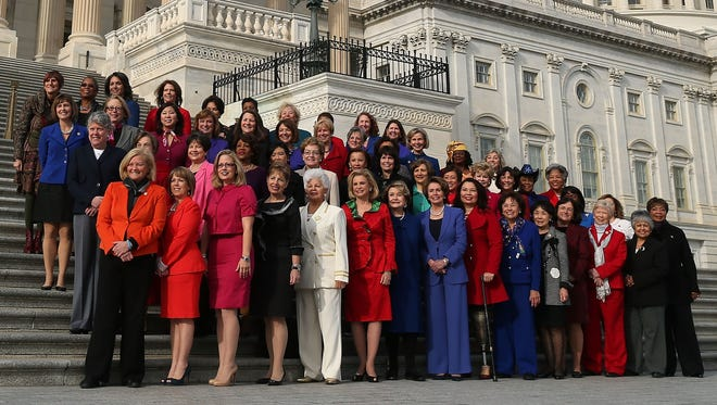 House Minority Leader Nancy Pelosi, D-Calif., in in blue pant suit in the center of the bottom row, poses with other Democratic women in the 113th Congress.