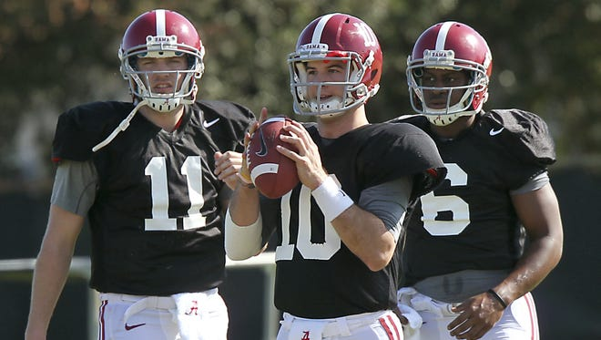 Alabama quarterback AJ McCarron (10) participates during practice  in Miami on Jan. 3 gearing up for the BCS title game.