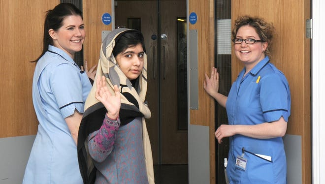 Malala Yousufzai waves goodbye as she is discharged from Queen Elizabeth Hospital on Friday.