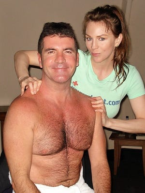 Dr. Dot, masseuse to the stars, with Simon Cowell.