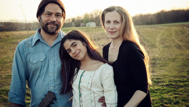 "Elizabeth Mitchell, right, husband Daniel Littleton, left, and their daughter, Storey have recorded an album of children's music, ""Little Seed."""