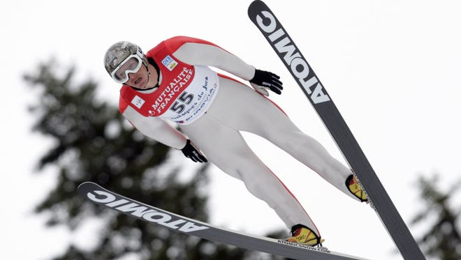 In this Jan. 16, 2010, file photo, Todd Lodwick of the United States, soars during the jump portion of the Nordic Combined Ski World Cup in Chaux-Neuve, eastern France.