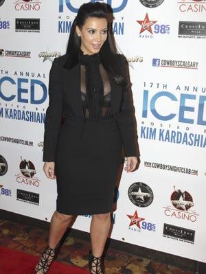 Kim Kardashian hosts ICED at Cowboys Dance Hall Friday in Calgary, Canada.