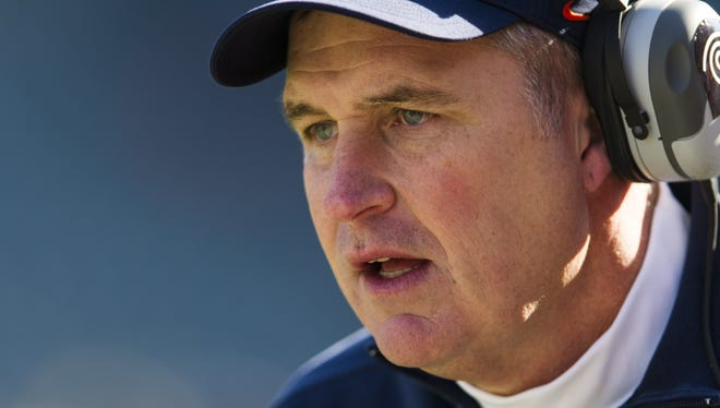 Syracuse coach Doug Marrone, shown in November, was hired as head coach of the Buffalo Bills, according to a report.