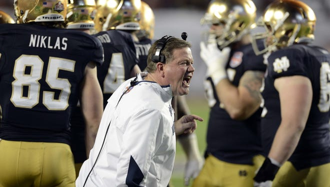 Notre Dame Fighting Irish head coach Brian Kelly yells out towards the field during the first half of the BCS Championship game against the Alabama Crimson Tide on Saturday.