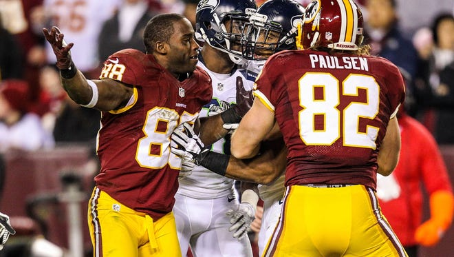 Washington Redskins wide receiver Pierre Garcon (88) reacts to having his helmet removed during the second quarter of the NFC Wild Card playoff game against the Seattle Seahawks at FedEx Field.