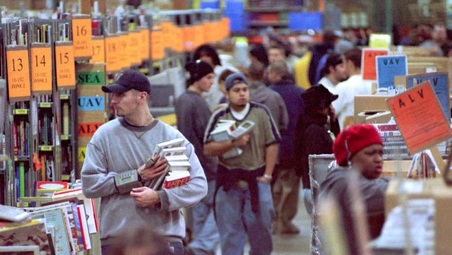 Amazon.com employees fill orders at its distribution center in Seattle.