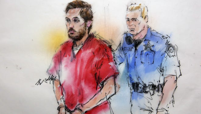 This courtroom sketch shows James Holmes being escorted by a deputy as he arrives at a preliminary hearing in district court in Centennial, Colo., on Jan. 7.
