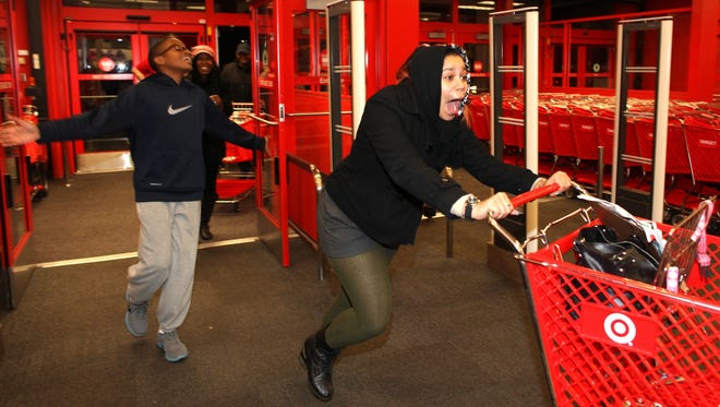 An excited online shopper entering a Target store in Chesapeake, Va., on Thanksgiving Day in 2012.
