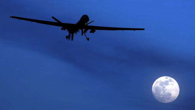 This Jan. 31, 2010, file photo shows a U.S. Predator drone above Kandahar Air Field in southern Afghanistan.