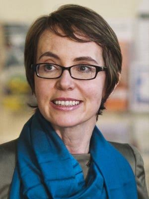 Gabrielle Giffords, as photographed Jan. 23, 2012, touring a food bank in Tucson.