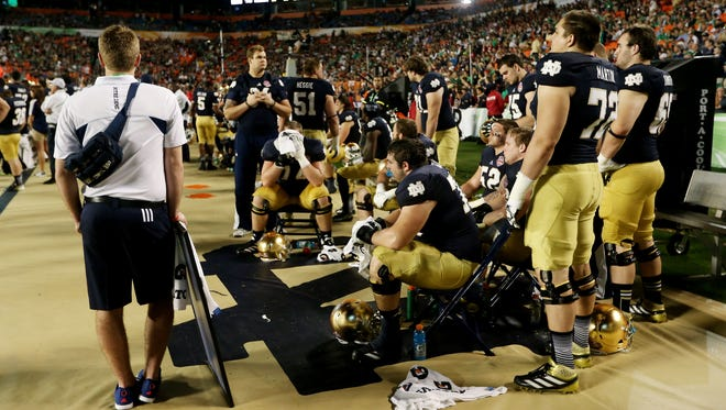 Notre Dame players look on after losing to Alabama 42-14 in the 2013 CS National Championship game at Sun Life Stadium on Monday. The outcome served as a bit of a reality check for the Fighting Irish.