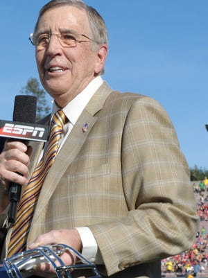 ESPN apologized Tuesday for remarks made by  Brent Musburger, right, about the girlfriend of Alabama QB AJ McCarron.