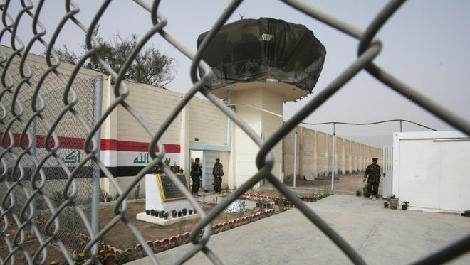 Guards stand at the entrance of a renovated Abu Ghraib prison in 2009 in Baghdad.