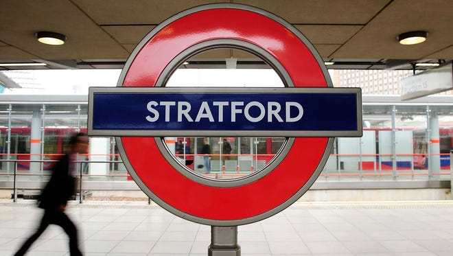 A person rushes through Stratford Station on July 16, 2012.