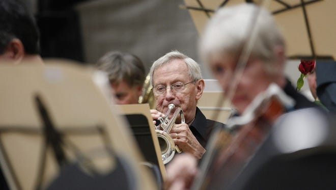 A retired trumpet player of the Musicians of the Minnesota Orchestra performs during the ACME Concert, a free event at the North Community YMCA,  in Minneapolis.