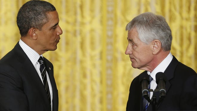 President Obama shakes hands with former Nebraska senator Chuck Hagel on Jan. 7 at the White House. Obama nominated Hagel to be secretary of Defense.