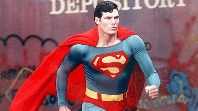 Christopher Reeve in action as the 1970s film version of Superman.
