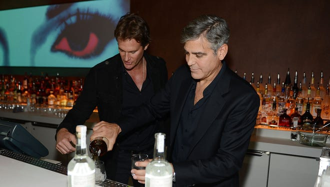 Casamigos Tequila founders Rande Gerber and George Clooney pour some drinks at Andrea's at Encore Las Vegas on Jan. 9.