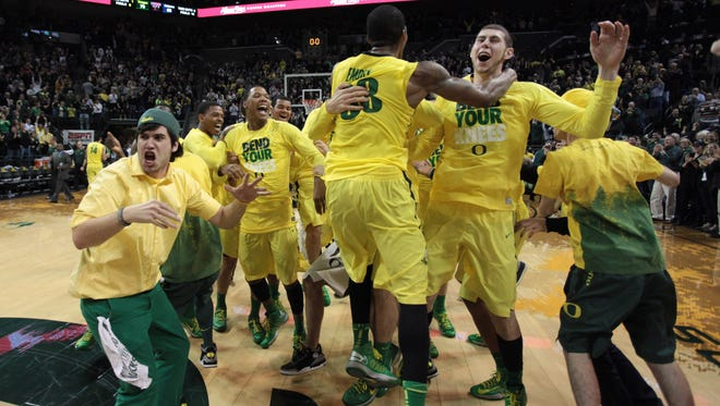 Oregon Ducks fans run onto the floor following a win against the Arizona Wildcats at Matthew Knight Arena. Oregon defeated Arizona 70-66.