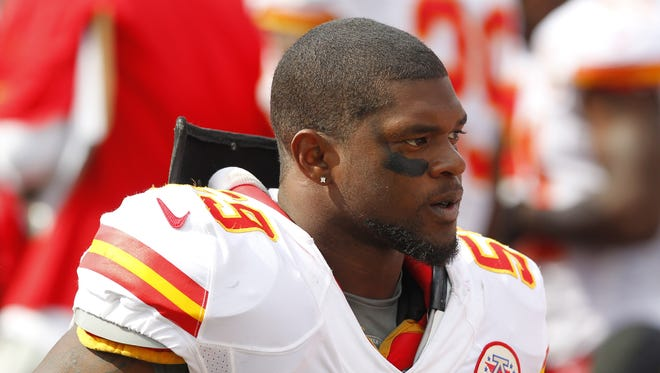 Jovan Belcher stands on the Chiefs' sideline during an NFL game in Orchard Park, N.Y.