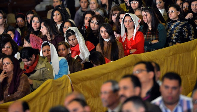 Egyptian Coptic Christian women attend Christmas midnight Mass at the al-Abasseya Cathedral in Cairo on Jan. 6.