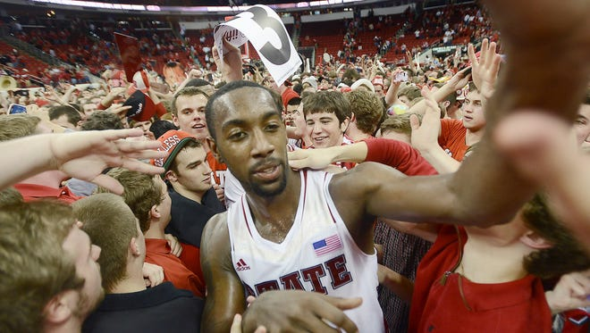 North Carolina State's C.J. Leslie celebrates with fans after the Wolfpack's 84-76 win over top-ranked Duke on Saturday.